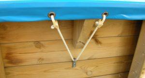 sistema di fissaggio di coperture invernali per piscine in legno fuori terra